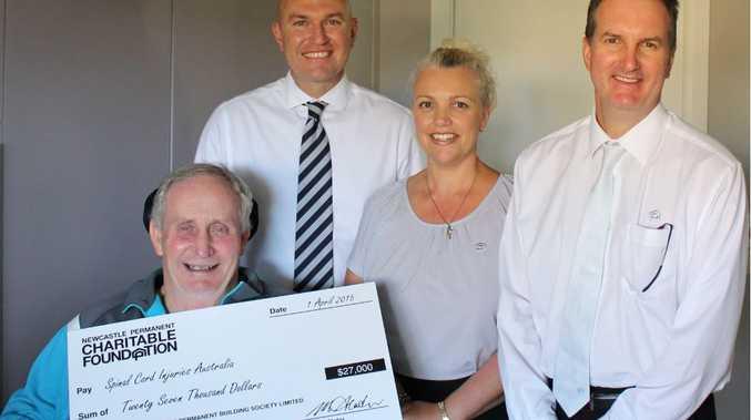 Spinal Cord Injuries Australia representative Jim Wicks (left) accepts the grant from Jason Bourke, Erica Farag and Darren Kidd.