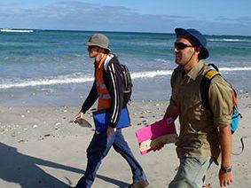 SCU marine science intern Toby Ekman with a fellow researcher on the beach at Gnaraloo.