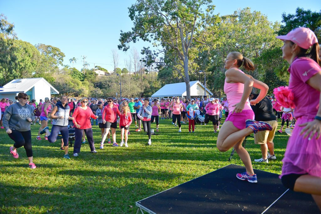 WARM UP: An energetic exercise routine warmed up the crowd before they started the four or eight kilometre run at this morning's Mother's Day Classic.