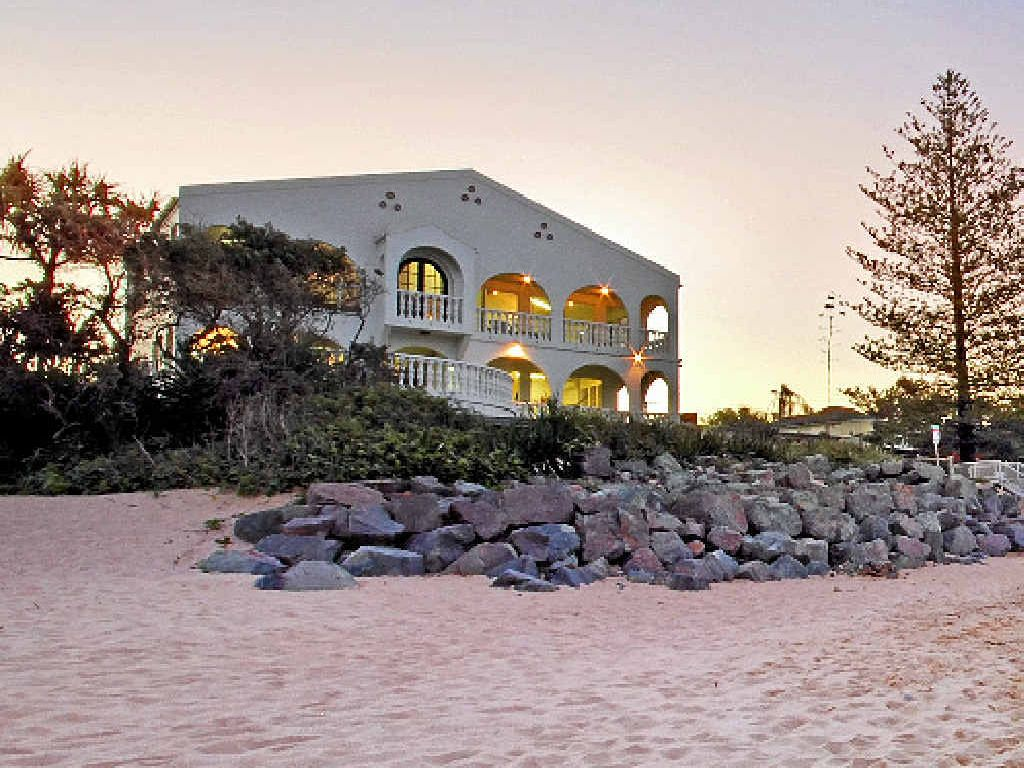 BEACHFRONT: The $4.9million property at 2 Cooroora St perched on Moffat Beach.