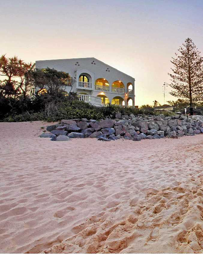 BEACHFRONT: The $4.9 million property at 2 Cooroora St perched on Moffat Beach.