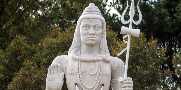 The upset neighbour compared the statue of the Hindu god Shiva to a Nazi swastika.
