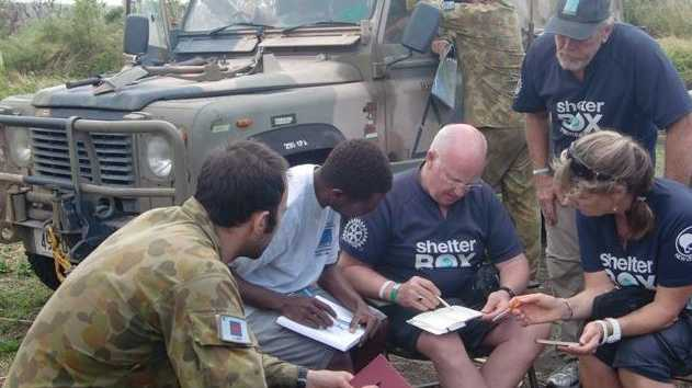 District 9650 Rotarians work on a Vanuatu emergency housing project in the wake of Tropical Cyclone Pam.
