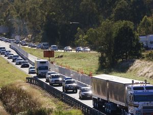 House on a truck and roadworks make for delays on highway