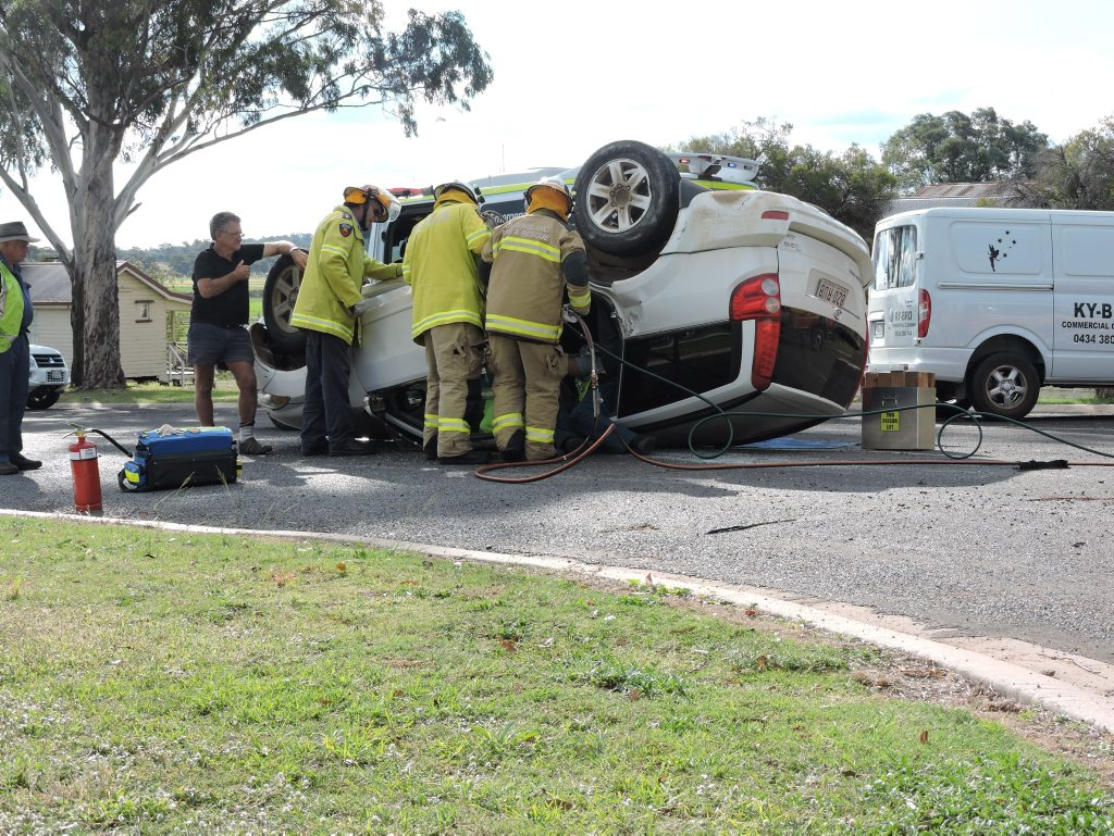 Fire and Emergency crews worked with paramedics to free the female driver trapped in her vehicle after it rolled over on Percy St Photo Sophie Lester / Warwick Daily News