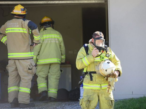 Fire fighters attempt at the scene of a house fire at Deebing Heights. Photo: David Nielsen / The Queensland Times
