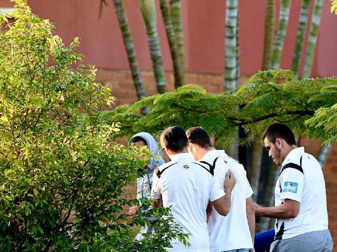 GRIEF HITS: Family, friends and players outside Ballina hospital after Zane Purcell died during the reserve grade rugby league game at Ballina on Sunday.
