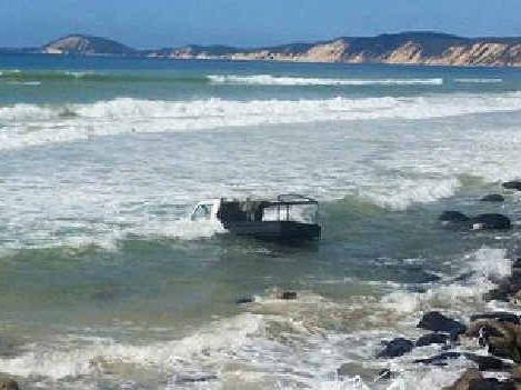 WET: This Land Cruiser endured three high tides at Rainbow Beach at the weekend.