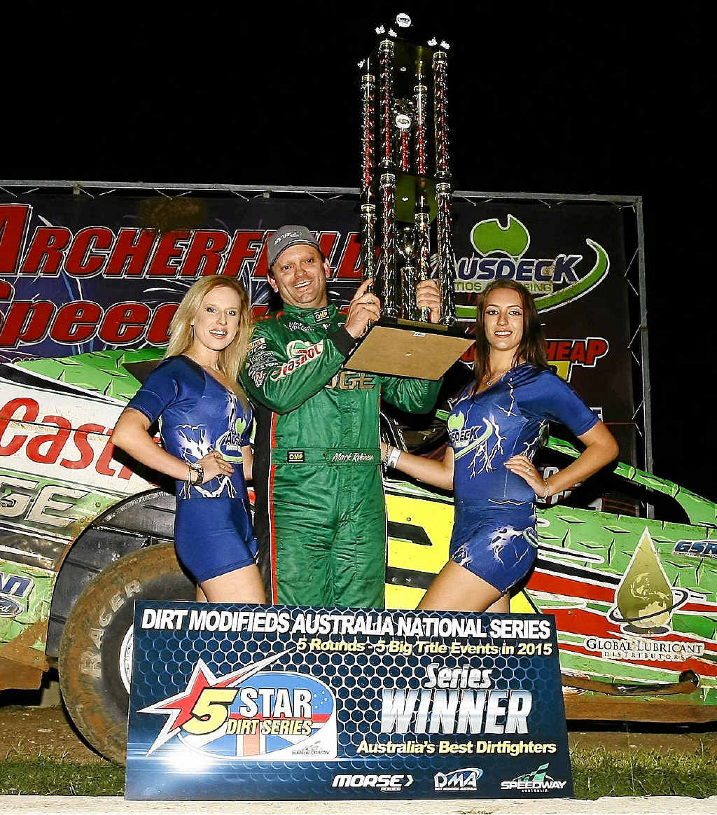 NEWLY-CROWNED: Queensland V8 Dirt Modified Championship winner Mark Robinson celebrates his victory.