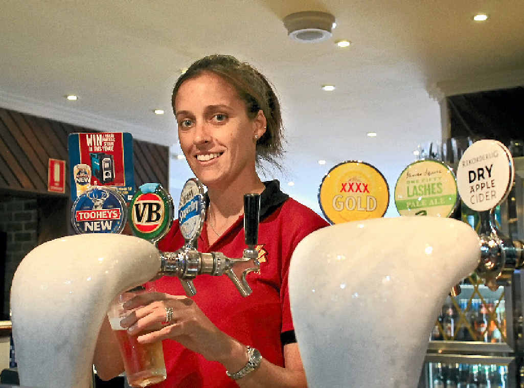 NEW IMAGE: Katie Faber, second-in-charge at the Ballina Hotel, behind the bar.