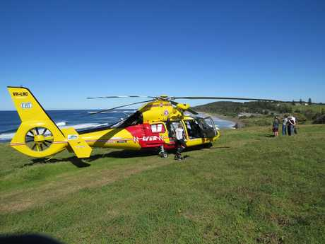 The Westpac Life Saver Rescue Helicopter on May 10, 2015 at Flat Rock beach where a surfer suffered suspected spinal injuries after being dumped by a wave.