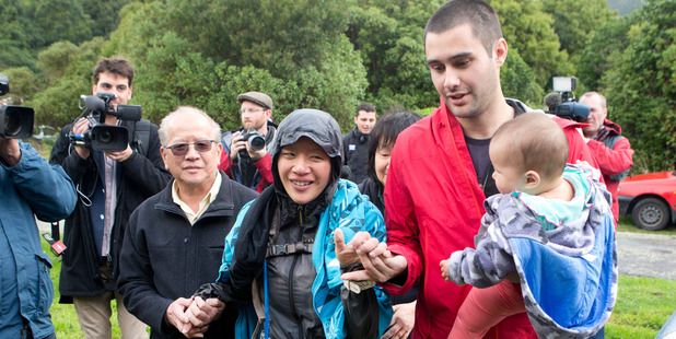 Missing runner Susan O'Brien is reunited with her family - father Andrew Khoo, mother Maggie Khoo and husband Daniel O'Brien - after being found in the Rimutaka Forest Park. Photo / Mark Mitchell