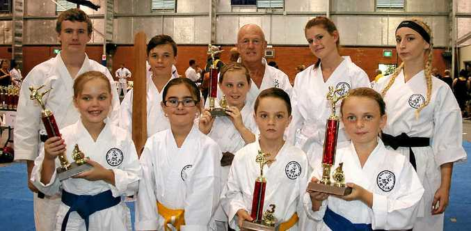 OUTSTANDING: Hard work paid off with a swag of trophies for the Kenseikan Karate crew.