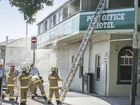 HOT MAIL: Firefighters spent more than four hours fighting a fire at Grafton's Post Office Hotel yesterday, although only smoke was visible at street level.