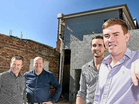 NEW PUB: The Office is being constructed at the rear of the converted Saba building in the CBD. At the site of the new bar are (from left) Graham Secombe and Wade Eiser from Aspect Architects with owners Michael Hay and Kenneth Wagner. INSET: The alleyway will be part of the bar.