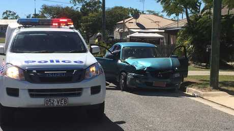 Police have arrested a man after a crash between a council truck and a Mazda in South Gladstone on Tuesday morning.