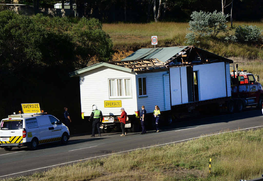 TIGHT SQUEEZE: A large traffic jam was created on the Cunningham Highway earlier this week when a truck carrying a house became stuck against roadworks barricades.