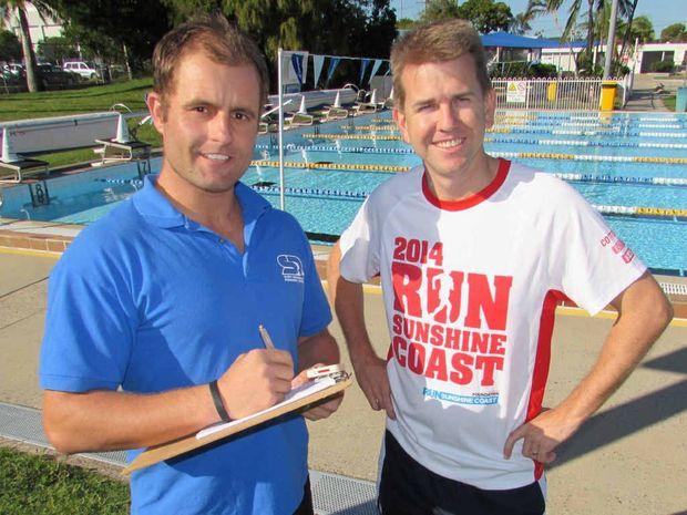 SAFE HANDS: Personal trainer Scott Drogemuller puts Jarrod Bleijie through his paces.