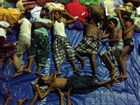 RESCUED: Asylum seekers sleep at a government sports auditorium in Aceh, Indonesia.