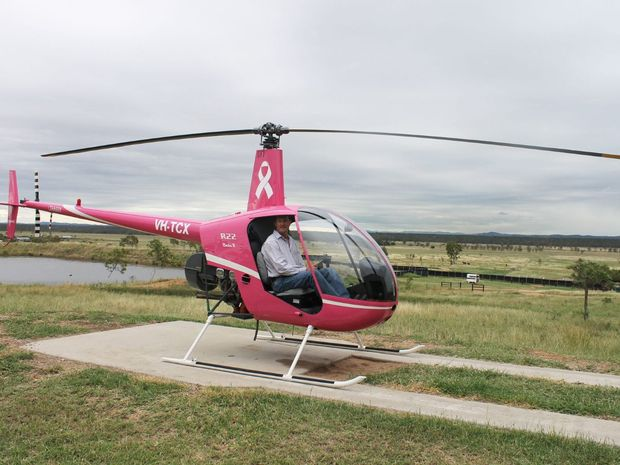 Cameron Parker in his newly refurbished pink helicopter.