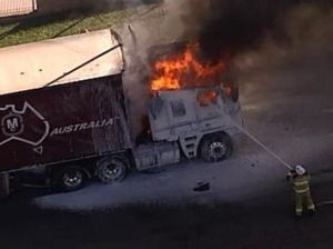Truck catches on fire near service station