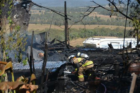 Firemen extinguish the last of the flames.