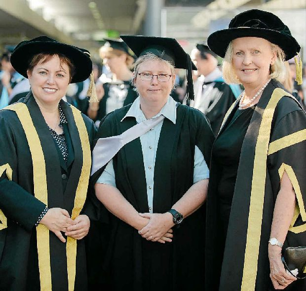 PASSION FOR TEACHING: Leah Campbell (centre) graduating at the University of Southern Queensland.