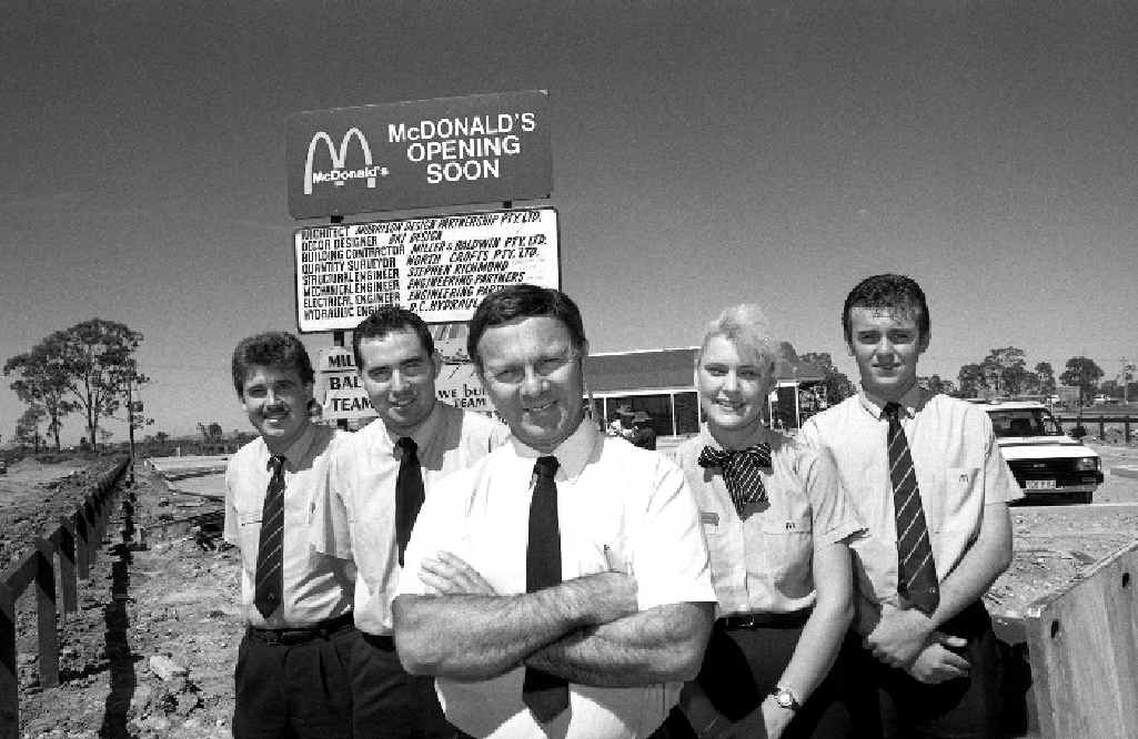 Ron Reseck (centre) and staff members (from left) Dean Bennett, Brent Gilmore, Angela Grieve and Trevor Rogers outside Mackay's first McDonald's Restaurant ahead of its opening in 1990.