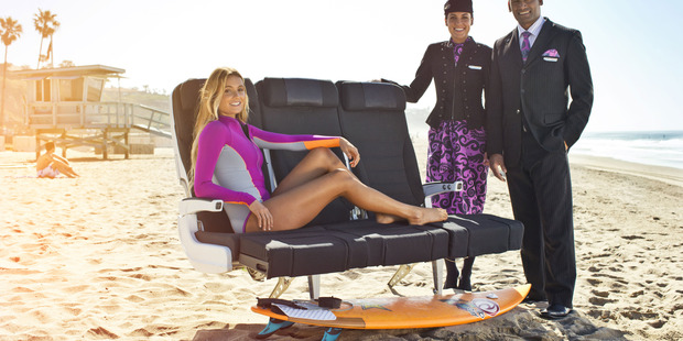 Alana Blanchard shows off Air NZ's Economy Skycouch.