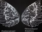 New York artist Kelsey Montague's large interactive wings art mural.