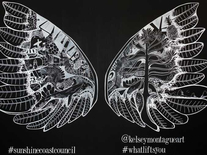 New York artist Kelsey Montague's large interactive wings art mural.