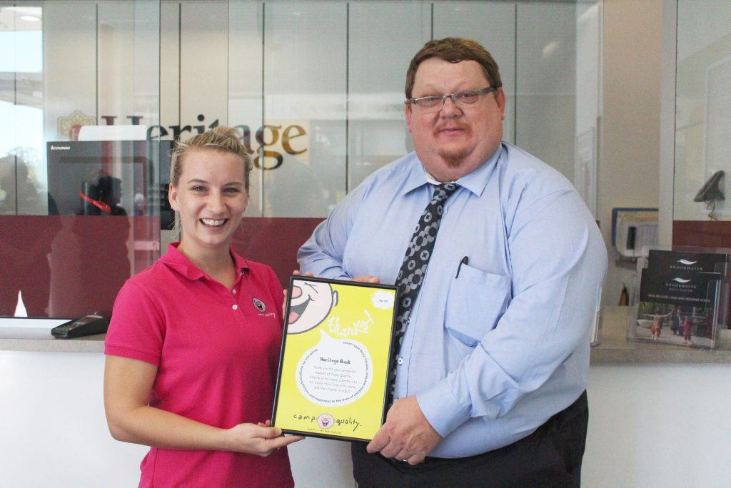Camp Quality Fundraising Coordinator Emma Vekar and Heritage Bank Regional Sales and Service Manager (Western Region) Ron Franks