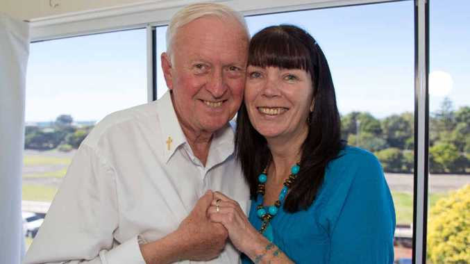 LOVE: Reverend Doctor Graham Whelan with fiance Wendy Tyndall at his home overlooking the Jetty area.