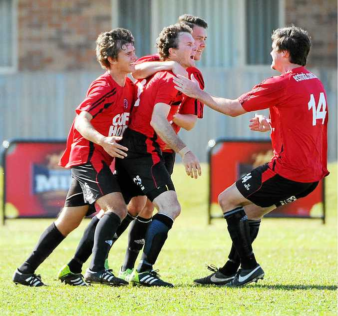 HIGH HOPES: Coach Mike Smith is planning hugs all round if the Lions win today's FFA Cup match.