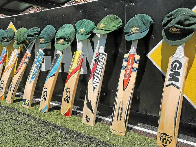 HUGHES HONOUR: The bats and caps of the Australian cricket team left by the field in a tribute to the late Phillip Hughes.