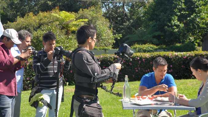Jason Godfrey & Jennepher Bucher filming at Maleny Cheese