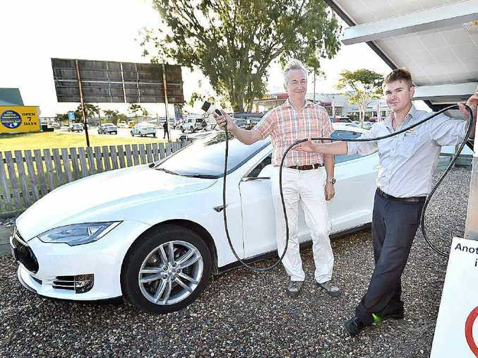 ELECTRIC CAR: Marc Talloen (left) is about to refuel his Tesla car with renewable solar energy while Toby Hunter, from Solar Power Wide Bay Burnett, is happy to assist him.