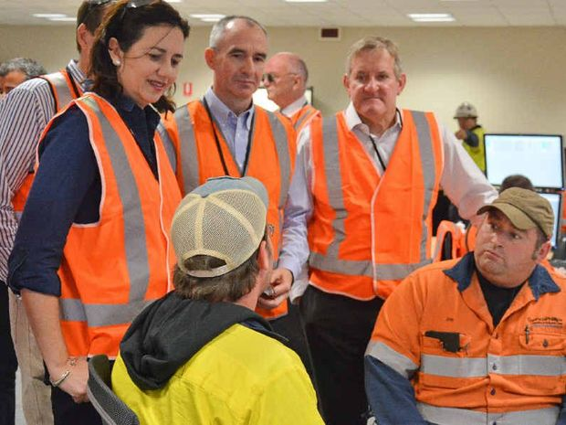 ON THE GROUND: Premier Annastacia Palaszczuk, QGC managing director Mitch Ingram and Federal Industry Minister Ian Macfarlane in the operations room talking to ConocoPhillips's Will James and Jon Boone.