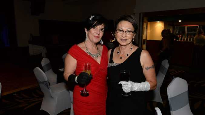 DIAMONDS AND PEARLS: Cathy Booth and Sharon Kinraid at the Umoja Charity Ball held at the Brothers Sports Club. Photo: Mike Knott / NewsMail