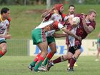 Casino player Damien Benn, being tackled by the Northern United players, Northern United vs Casino, at Oakes oval in Lismore. Photo Mireille Merlet-Shaw / Northern Star