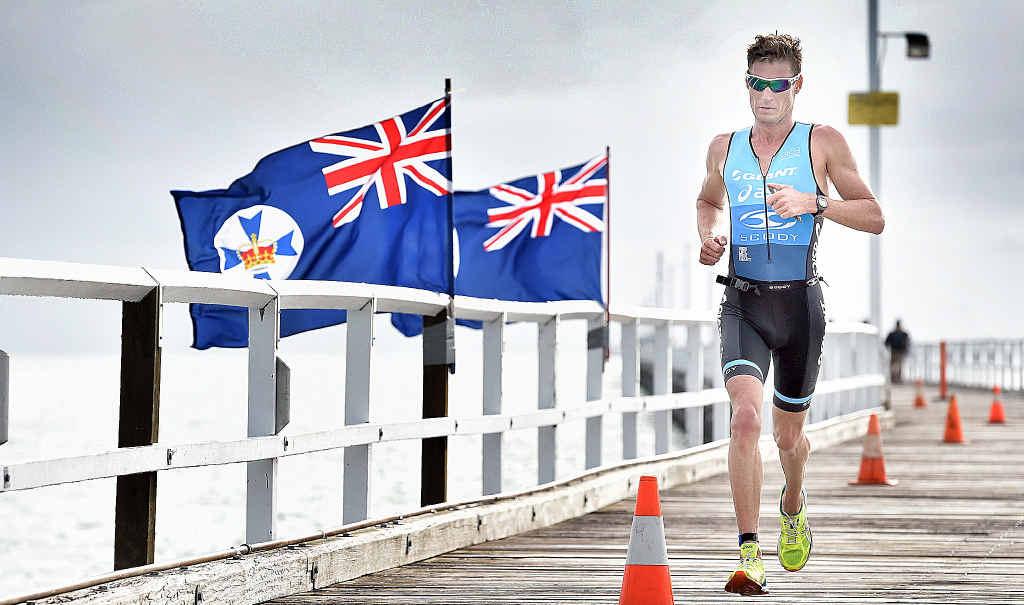 FLYING: Tri Fraser Coast overall winner Brad Kahlefeldt makes his way along the Urangan Pier towards the finish line.