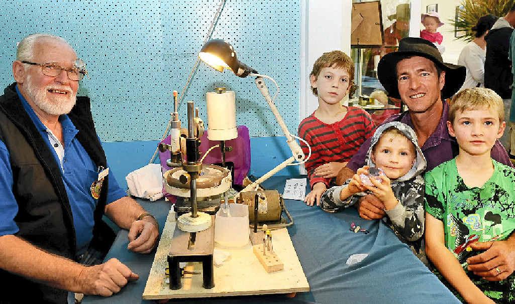 CUT ABOVE: David Courage with Aslan O'Keefe and Eron, Koen and Tumahn Young.