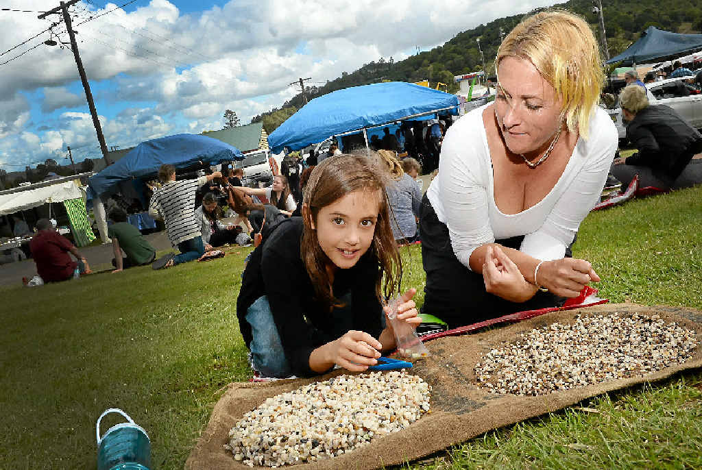DIGGING IT: Tash Kernahan and daughter Hannah, 8, try their luck fossicking at Gemfest in Lismore.