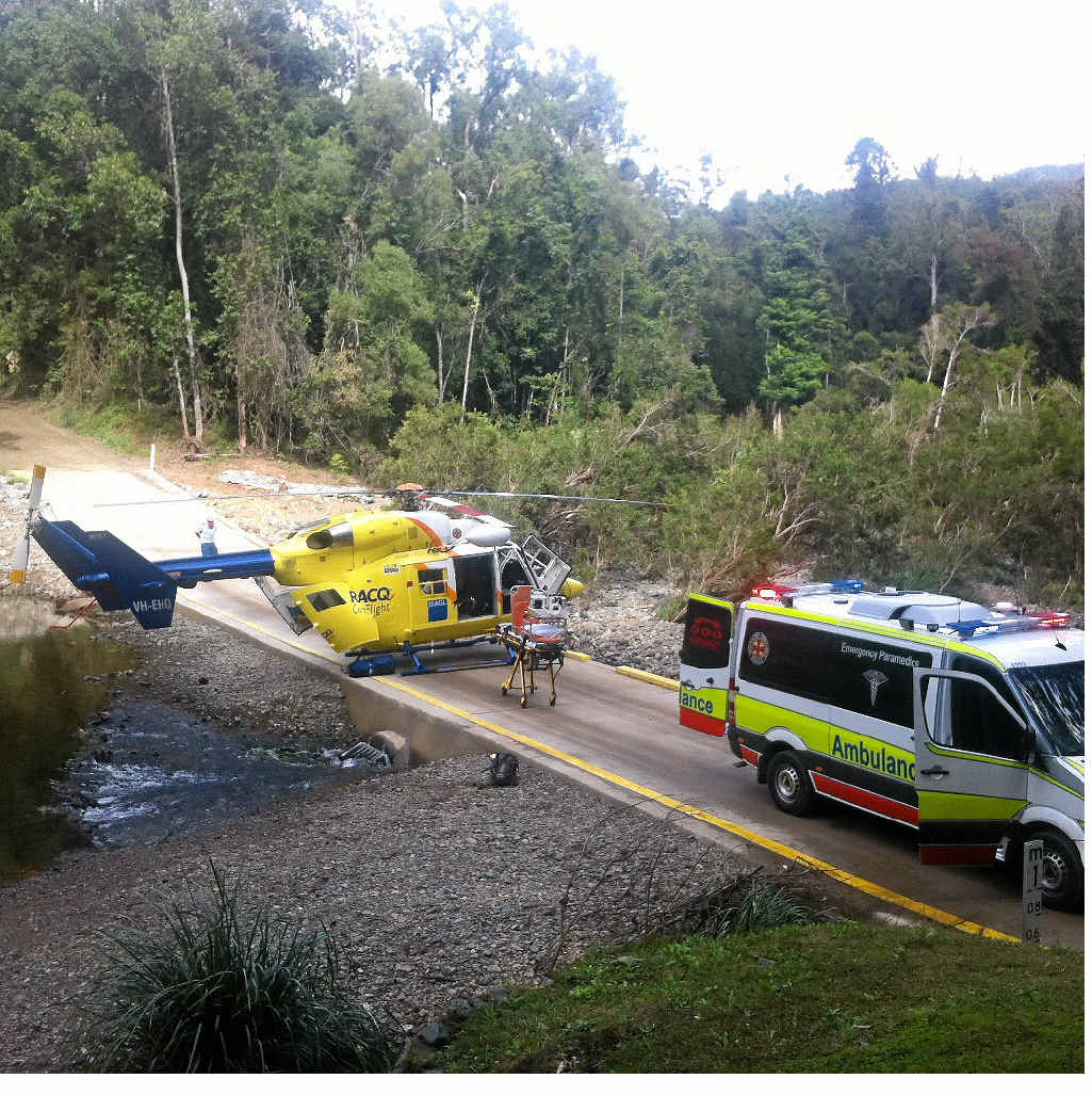 The Sunshine Coast RACQ CareFlight Rescue helicopter lands briefly near Imbil as part of a mission to help an injured trail bike rider.