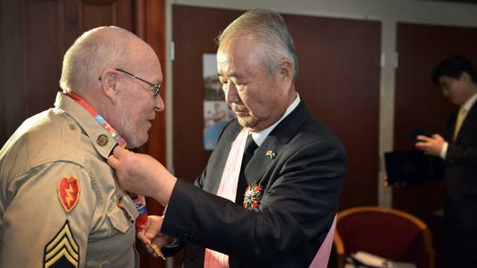 Former Defence Minister of the Republic of Korea General Kwon Young Hae (retired) presents American medic and padre Donald Nutting with a special medallion commemorating the 60th anniversary of the war.