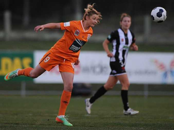 BRISBANE, AUSTRALIA - SEPTEMBER 27: Larissa Crummer of the Roar heads the ball during the round three W-League match between the Brisbane Roar and the Newcastle Jets at Perry Park on September 27, 2014 in Brisbane.