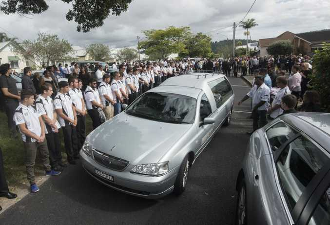 Zane Purcell's coffin is driven away from the Anglican church in Maclean through a guard of honour after his funeral. Photo Adam Hourigan / The Daily Examiner