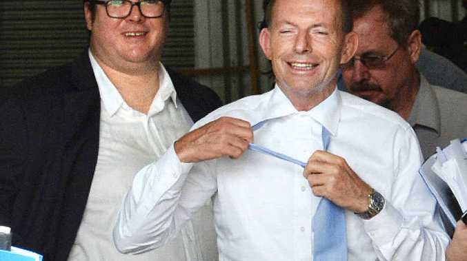 Prime Minister Tony Abbott's tie comes off, standing next to George Christensen.