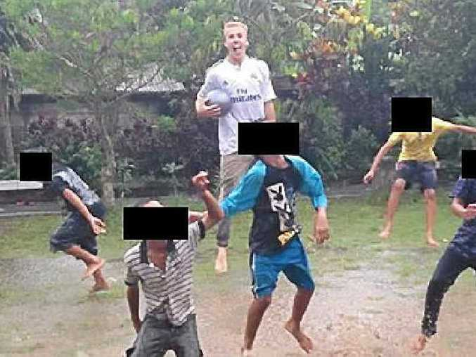 HAPPY PHOTO: Oliver Bridgeman's Facebook page shows him playing football with children in Bali.