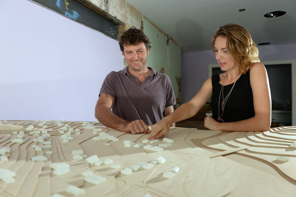 Andrew price and Kacey Cliffard look at a plan of Tyalgum. Photo: John Gass / Tweed Daily News